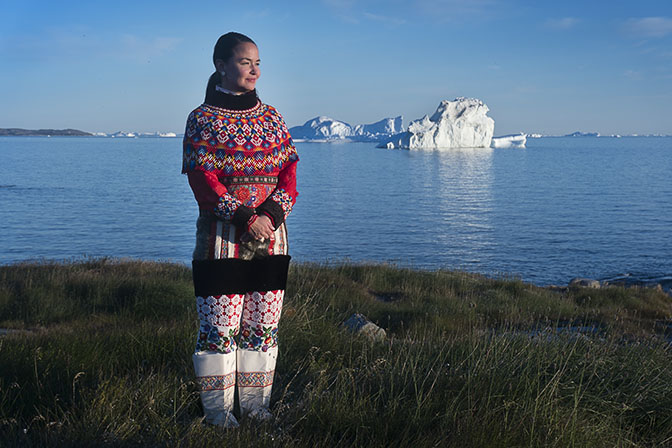 Paarna, an Inuit woman, in traditional outfit on the beach of the village of Rodebay, 2017