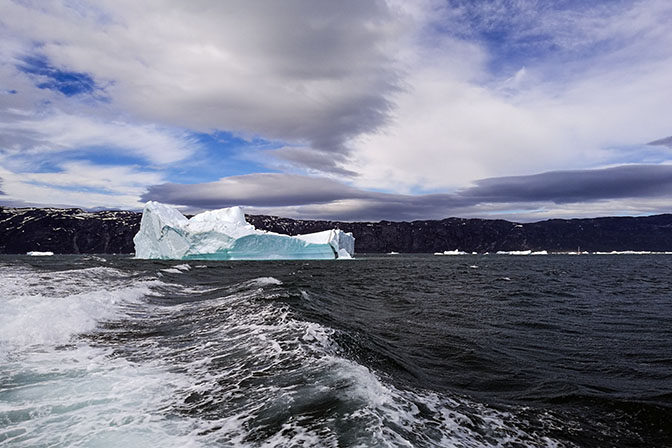 Floating iceberg and foaming trail from the boat, 2017