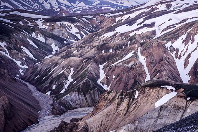Intermixture of rhyolite colors with ice in golden light, view from Blahnukur mountain, Landmannalaugar 2017