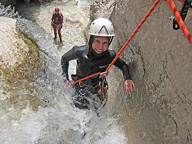 Me, rappelling (abseiling) a wild waterfall in the Mlinarica River, 2007 (photographed by Urban Herzog)