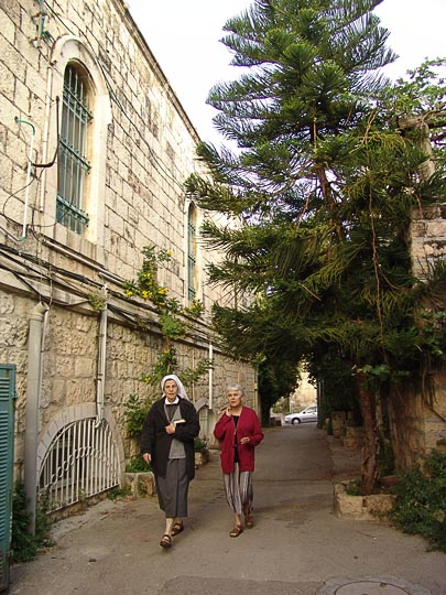 Sisters from The Monastery of Les Soeurs de Notre-Dame de Sion rush to the morning Mass through the alleys of Ein Kerem, 2008