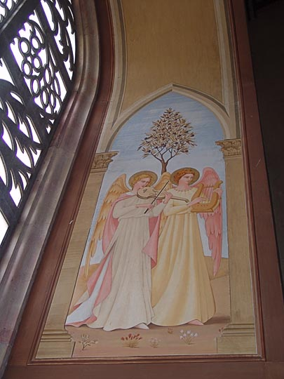 Mural of angels sing and play by a window decorated with palms and palmettos in The Church of the Visitation, Catholic-Franciscan Fathers, 2008