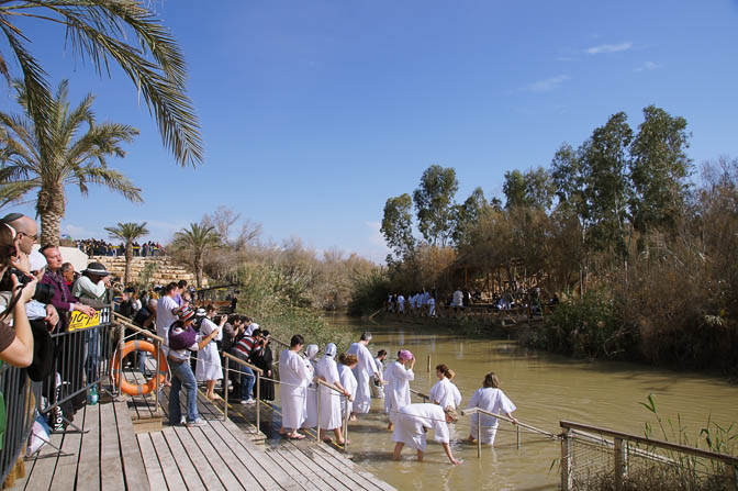 Pilgrims in white gowns about to immerse in Jordan River, the Baptismal Site Qasir alYahud 2012