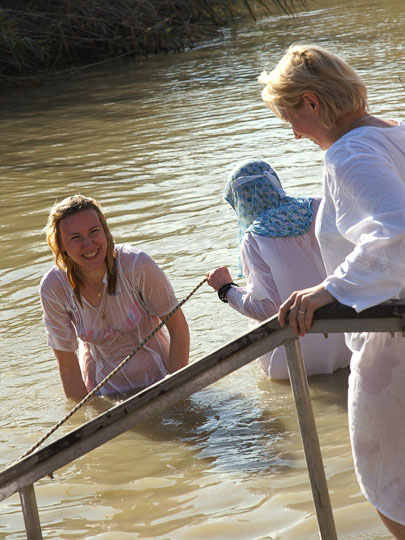 Pilgrims immersing in the Jordan River and smiling happily, the Baptismal Site Qasir alYahud 2012