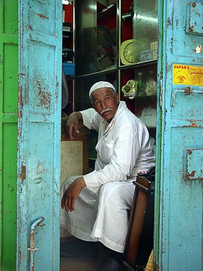 An Arab merchant in the entrance of a small shop in the market, The Old City 2003