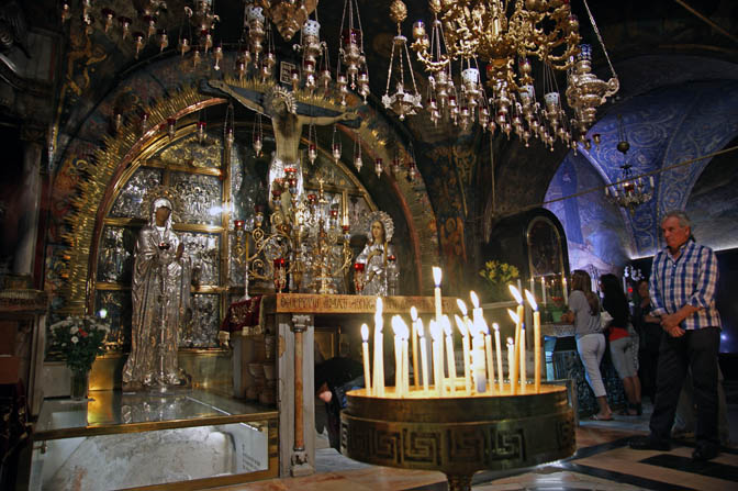 People waiting their turn to pray in the Greek altar at Calvary, or Golgotha, inside the church of the Holy Sepulchre, The Old City 2011