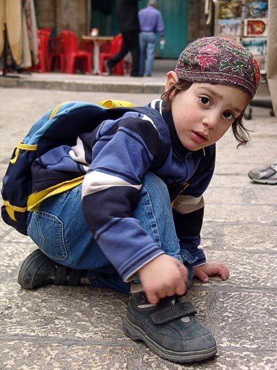 A Jewish kid on his way back from school, in an old city alley, 2006