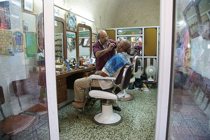 A barber at work in Ha-Shalshelet street, The Old City 2008