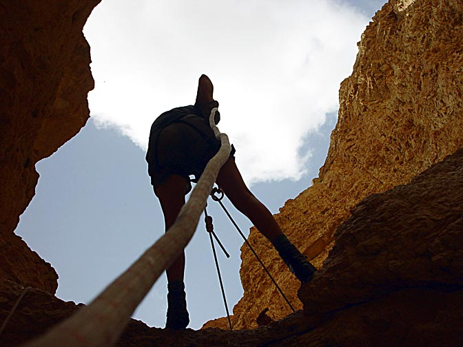 A rappelling (abseiling) silhouette in the Hardoof Creek, 2003