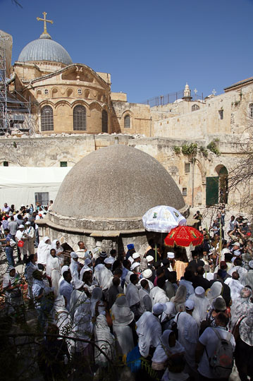 Orthodox Ethiopians circuit a structure in Deir al Sultan, on the roof of the Chapel of St. Helena of the Holy Sepulcher, Jerusalem 2012