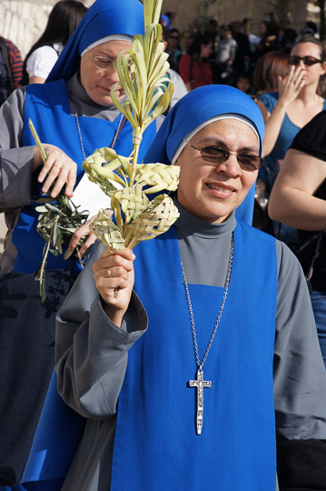 Franciscan nuns raising palm-made decorations in the procession, Mount of Olives 2012