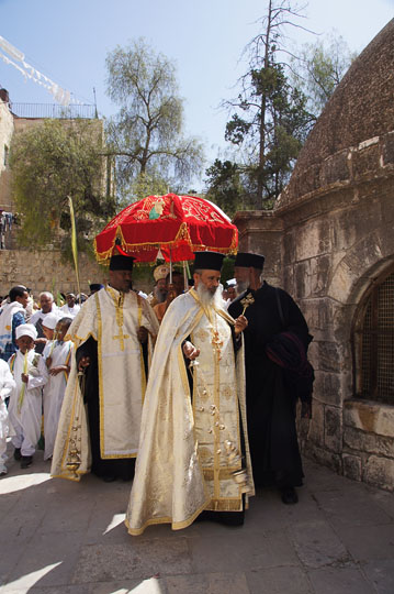 Ethiopian clergymen circle a structure in Deir al Sultan, on the roof of the Chapel of St. Helena of the Holy Sepulcher, Jerusalem 2012