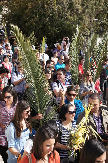 Pilgrims raising palm branches in the Catholic and Protestant procession, Mount of Olives 2012