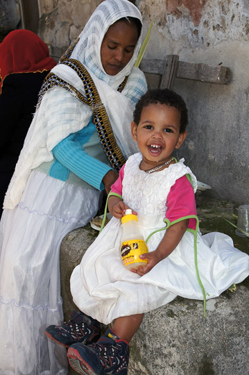 Sweet Ethiopian girl in a party dress, in the Ethiopian village of Deir al Sultan, Jerusalem 2012