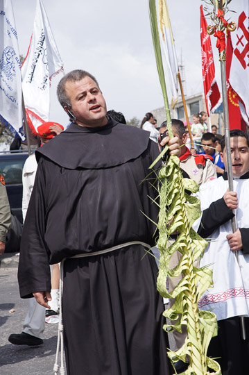 Protestant monk carrying a braided palm branch in the Catholic and Protestant procession, Mount of Olives  2012