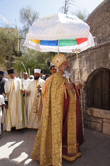 Ethiopian clergymen raising palm branches, surround a structure in Deir al Sultan, on the roof of the Chapel of St. Helena of the Holy Sepulcher, Jerusalem 2012