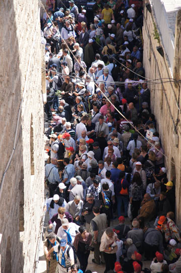 Pilgrims crowding the alleys of the old city  on their way to the Holy Sepulcher, Jerusalem 2012