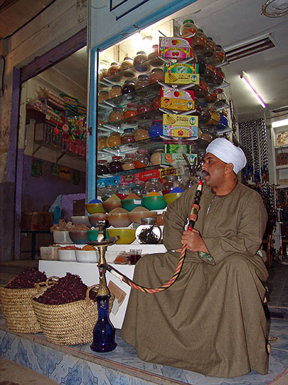 A local merchant smoking Nargila in a local Suq (street market), Luxor 2006