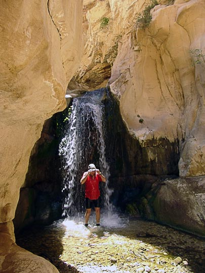 Ishai showers under a waterfall in Wadi el Karak, 2007