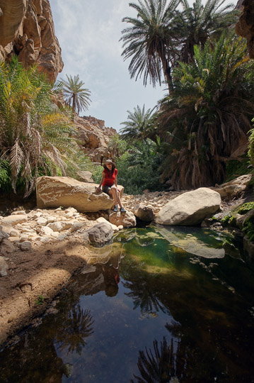Tanya between pools and the rich vegetation of Wadi Manshala, 2012
