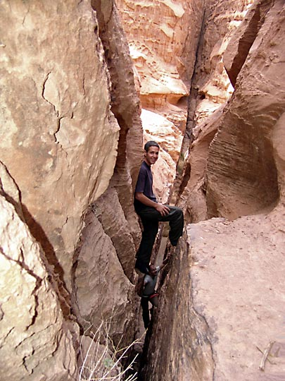 Aviv and Francois climbing up a narrow crack in the Mohammed Musa Route in Jabel Um Ishrin, 2006