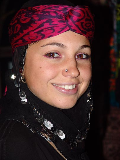 A beautiful young woman in a traditional head cover, in a restaurant in Yukari Kavron, 2005