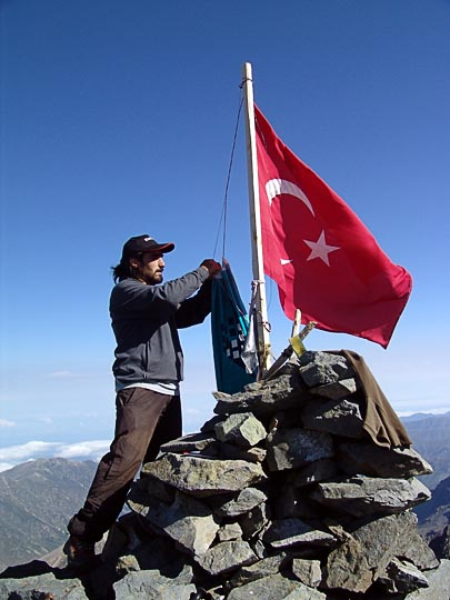 Ali takes care of the Turkish flag in the Kachkar summit, 2005