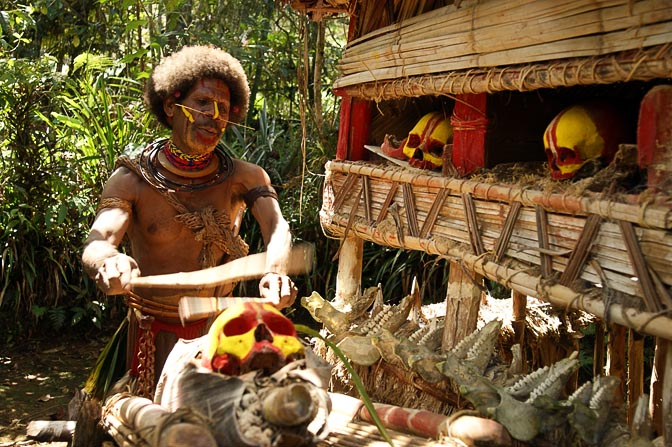 A Huli Tribe Fortune Teller is performing a ritual with his ancestors' skulls, Tari 2009
