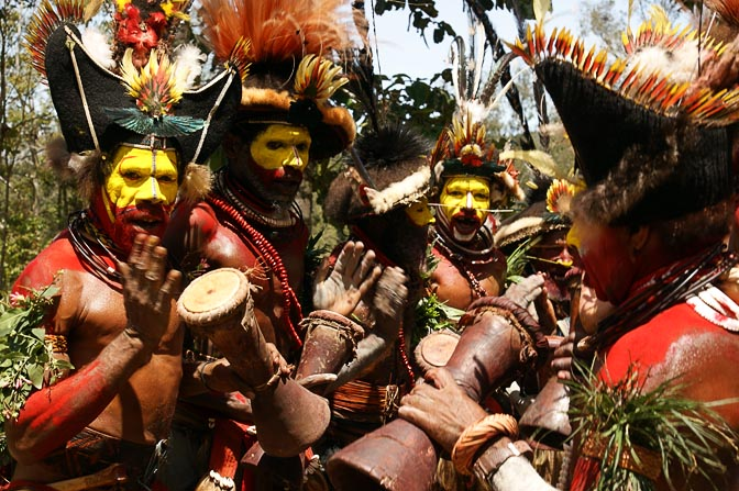 Huli Tribe wigmen play the Kundu drums in a singsing (cultural show), Tari 2009