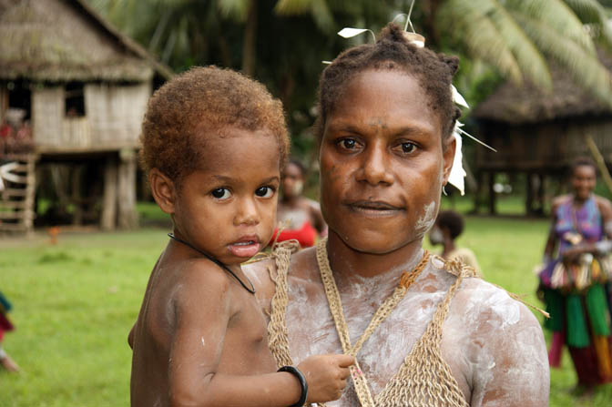 A mother carrying her girl in Kararau, the Sepik River 2009