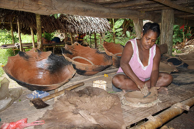 A potter forms a clay oven in Aibom, the Sepik River 2009