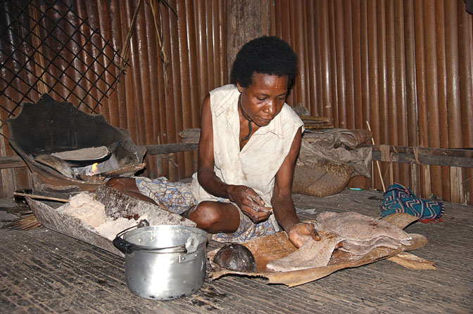 Sago pancake preparation in a clay oven in Yamok, the Sepik River 2009
