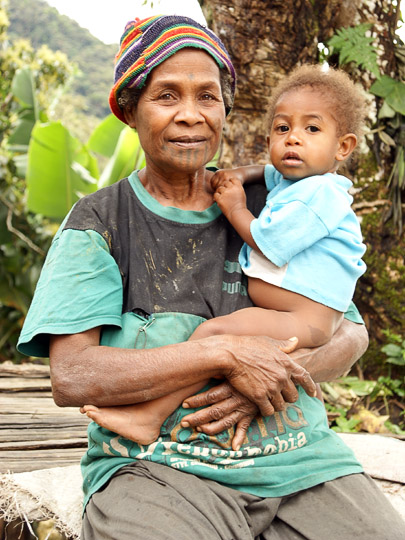 A woman and a baby in a village along the trail, The Kokoda Trek 2009