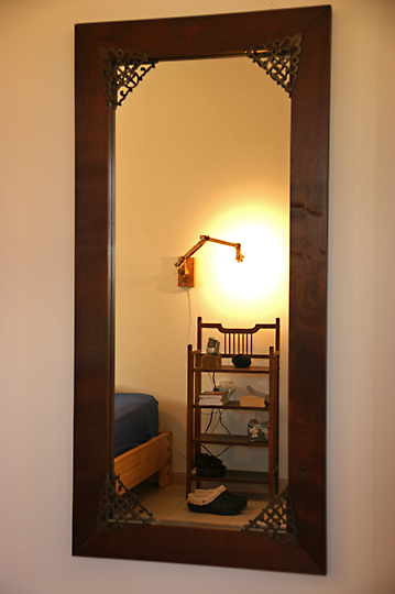 A bedroom reflection in the mirror, 2009