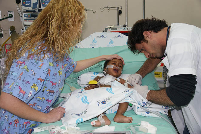 Dr. Eyal Nakash and nurse Bella treat Marcos from Angola, The Wolfson Hospital 2011