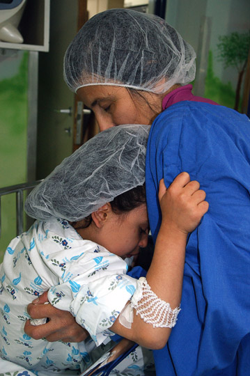 Hawraz from Iraqi Kurdistan hugs her mom goodbye in the surgery preparation room, The Wolfson Hospital 2011