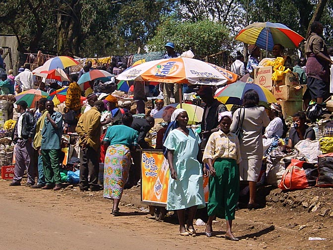 Colorful dressed people in the Nairobi market, Kenya 2000