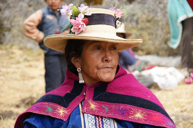 A Chola (local woman) with a flower-strewn hat, at her grandson's school picnic, Hatun Machay, Cordillera Negra 2008