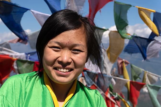 Bhutanese young woman at Chele La mountain pass, at altitude 4,000m, 2018