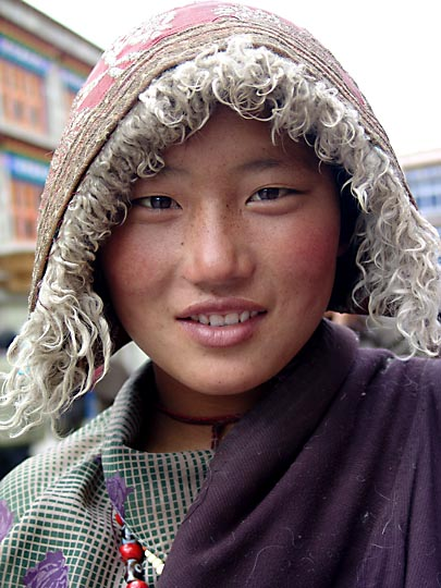 A Tibetan young woman along by the Lingkor around the Jokhang, Lhasa 2004