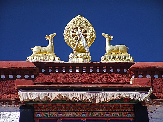 The Dharmacakra, the Wheel of Dharma, a Tibetan Symbol, decorating the top of a temple nearby Lhasa, 2004