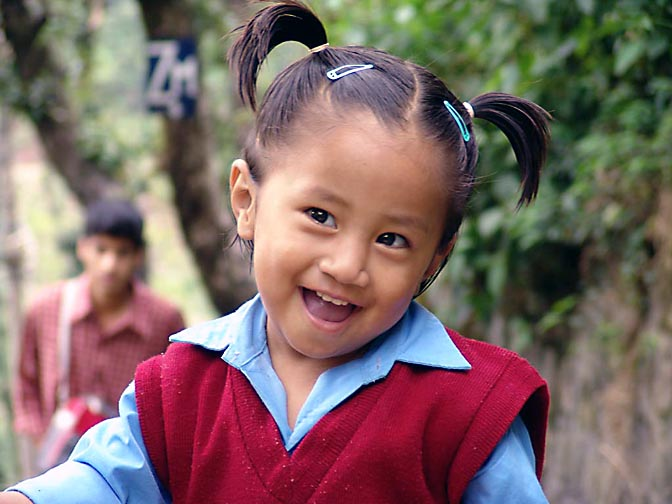A smiling Tibetan girl from Yongling school in McLeod Ganj, 2004