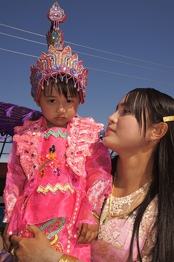 A mother and daughter adorned in The Buddhist Donation Ceremony parade, Popa 2015
