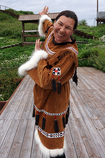A young Itelmen woman in traditional dress performing a dance movement, Kuril Lake 2016
