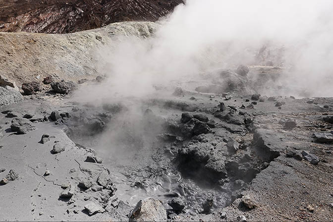Bubbling and steaming mud pool in the caldera of Mutnovsky active volcano, 2016