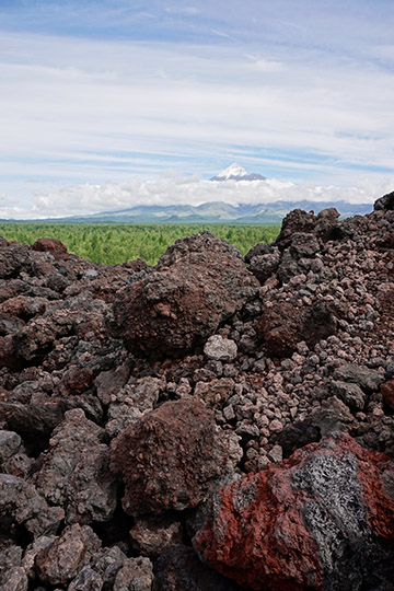 The lava barrier created during Tolbachic Volcano eruption on 2012-2013, with Ostry (pointy) Tolbachik in the background, 2016