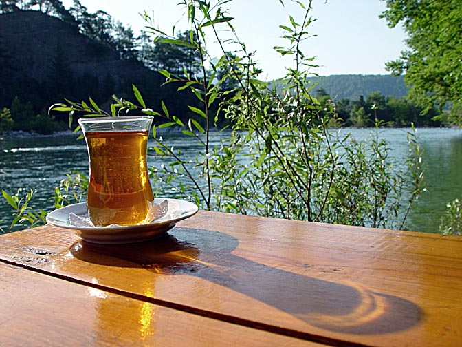 A glass of Chay (tea), Turkey's national drink, at Husni's place on the bank of the Koprulu Canyon (Kopru River), Antalya, Turkey 2002