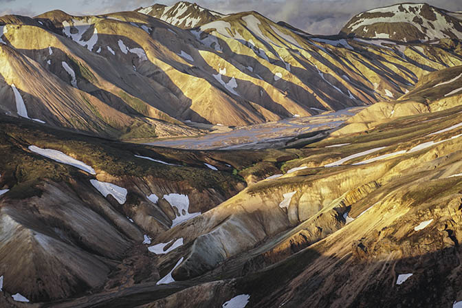 Colorful rhyolite mountains shine brightly in the sunset, view from Blahnukur mountain, Landmannalaugar 2017