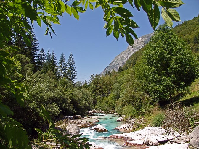 The emerald blue water of the Soca river flows across white gravel-beds, the Soca Trail 2007