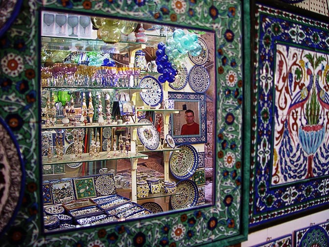 A reflection of colorful Armenian style decorated pottery and Hebron glass in the market, The Old City 2003